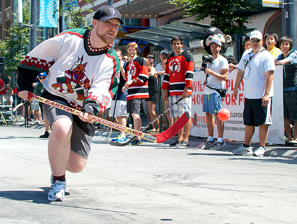 Ryan wears a Jeremy Roenick Peyote Coyotes jersey at the Five Hole for Food finale in Vancouver. Photo by Jason Kurylo for Pucked in the Head.