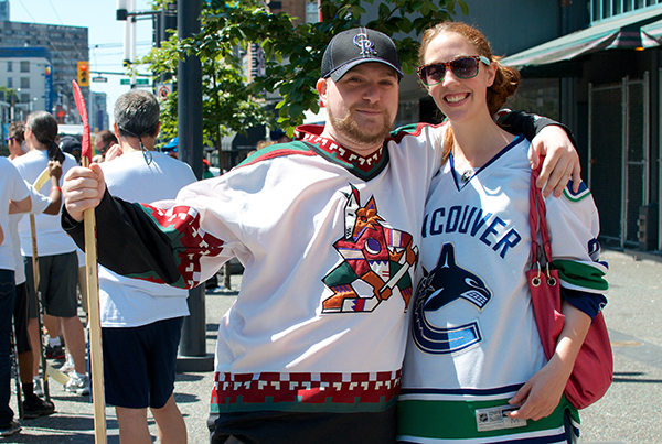 Ryan Mance wears Peyote Coyote with his fiancé Alix Wright in her Vancouver Orca jersey. Five Hole for Food held their annual finale on Granville Street in Vancouver on 20 July 2013.