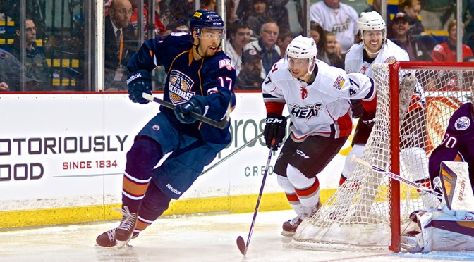 Heat forward Sven Baertschi chases OKC Barons defenseman Darnell Nurse during the last regular season AHL game to be held in Abbotsford. Photo by Jason Kurylo for Pucked in the Head.