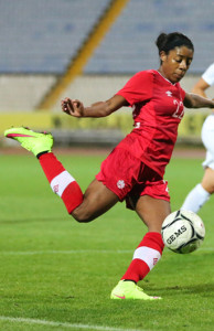 Team Canada midfielder Ashley Lawrence lays her right foot into the ball during an international friendly against England. Photo courtesy of Soccer Canada.