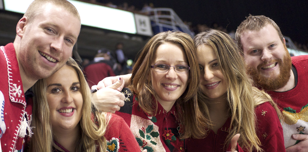 These beautiful Aussies were some of the most vocal ugly sweater wearers at a 2012 Giants game — we at PITH challenge you to outdo them this year! Photo by Jason Kurylo for Pucked in the Head.
