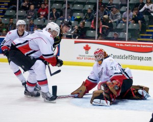 Barry Brust makes saves of all kinds for the Abbotsford Heat, including this athletic pad stop in traffic. Photo by Jason Kurylo for Pucked in the Head.