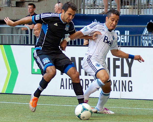Camilo da Silva Sanvezzo battles defender Steven Baiteshour during a 2-0 Whitecaps FC victory at BC Place. Photo by Jason Kurylo for Pucked in the Head.