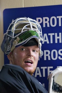 Vancouver Canucks goaltender Cory Schneider leans against the wall post-practice at UBC's Thunderbird Arena. He's entitled, after a 20-hour commute, a morning workout and a full practice with his NHL teammates. Photo by Jason Kurylo for Pucked in the Head.