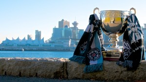 The Cascadia Cup wears Whitecaps FC, Southsiders and Rain City Brigade scarves (and a Curva Collective shirt for good measure) as it looks over Vancouver, its home for the 2014 MLS season, from a piece of prime Stanley Park Seawall real estate. Photo by Jason Kurylo for Pucked in the Head.