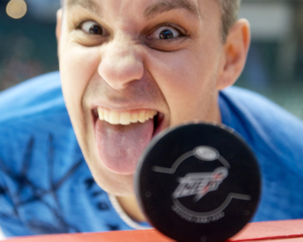 Abbotsford Heat photographer Clint Trahan is, like, sooooo serious all the time. It's a drag just being around the guy. Sheesh. Photo by Jason Kurylo for Pucked in the Head.