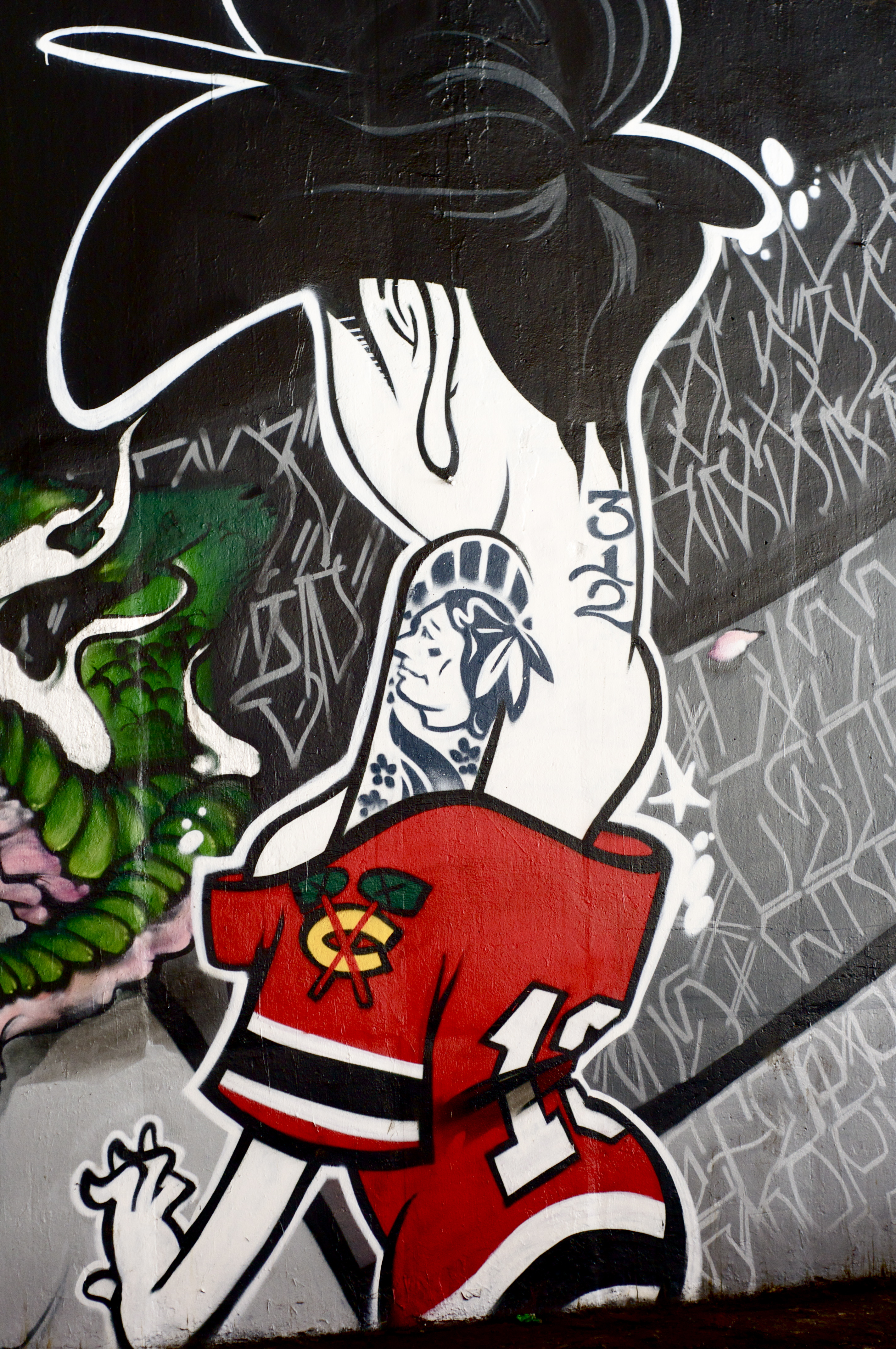 Chicago post 1 graffito pucked in the head for Blackhawks mural chicago