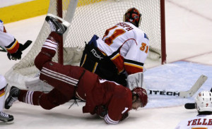 Shane Doan displays perfect form as he slips a shot between the legs of Curtis Joseph. Photo squirmed away from the interweb.