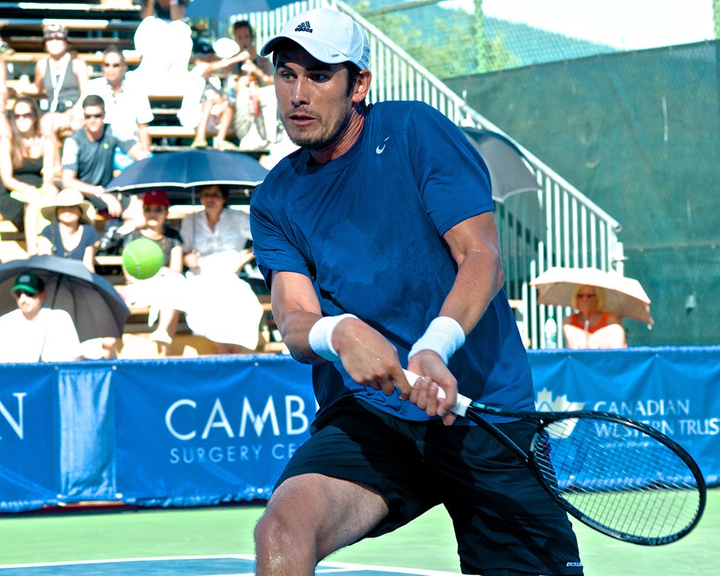 Fourth seed Farrukh Dustov  moves well for a big man, but he just couldn't quite keep up with the top dog Marcos Baghdatis in the 2014  Vancouver Open final. Photo by Jason Kurylo for Pucked in the Head.