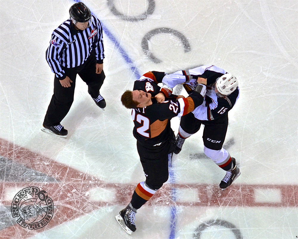 Owen Hardy punching Bryce Platt. Photo by Jason Kurylo for Pucked in the Head.