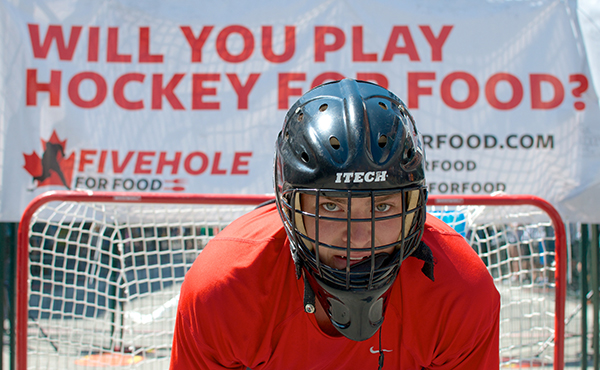 Five Hole for Food raised over 135 metric tonnes of food for regional food banks this year alone. Along the way, thousands of participants played ball hockey in downtown locales across Canada. Photo by Jason Kurylo for Pucked in the Head.