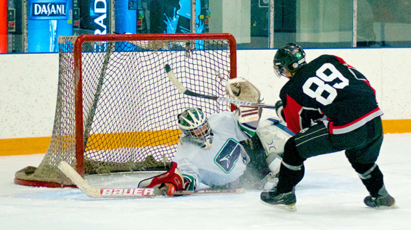 The CBC's Grant Lawrence makes a diving save with his mask during Duffers League action in North Vancouver. (The puck is actually visible under his neck protector if you look for it.) Photo by Jason Kurylo for Pucked in the Head.