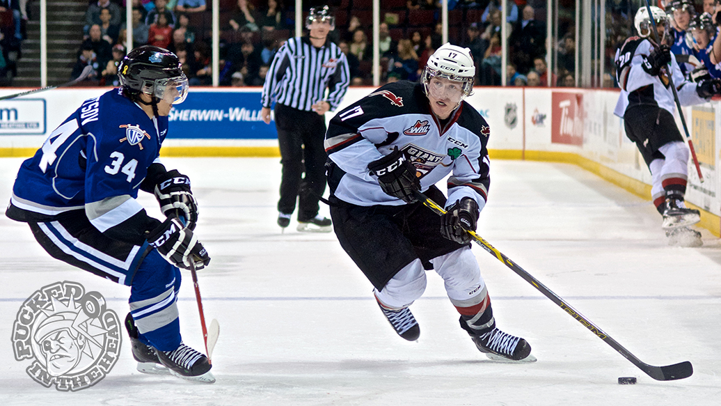 Tyler Benson of the Vancouver Giants wheels into the offensive zone, eyed up by defenseman Alexey Sleptsov. Photo by Jason Kurylo for Pucked in the Head.
