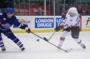 Rochester Americans forward Cody Hodsgon gets his stick in the way of a TJ Brodie shot during the a 5-2 win over the Abbotsford Heat. Photo by Jason Kurylo for Pucked in the Head.
