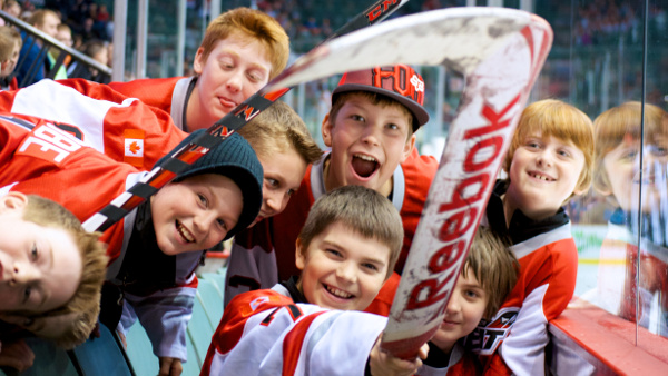 Members of the Abbotsford Heat youth hockey program celebrate receiving game-used sticks from the home team during a pair of games against the Grand Rapids Griffins. Photo by Jason Kurylo for Pucked in the Head.