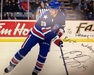 Rochester Americans forward and Buffalo Sabres prospect Cody Hodgson was kind enough to sign an 8x10 of a shot I took the night before. Photo of a Jason Kurylo photo for Pucked in the Head by Jason Kurylo for Pucked in the Head. Whoa. Meta.