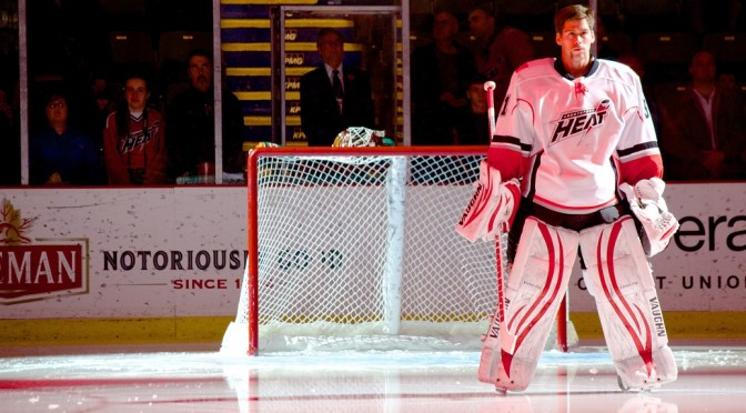 Joni Ortio, recently named to the 2013-14 AHL All-Rookie Team, backstops the Abbotsford Heat as the rev up for post-season play. Photo