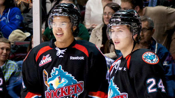 Game seven hero Tyson Baillie (#24, right) and his overtime assist man Madison Bowey during a pre-game warmup. The Kelowna Rockets became just the second team in WHL history to complete a series comeback after losing the first three games. Photo by Jason Kurylo for Pucked in the Head.
