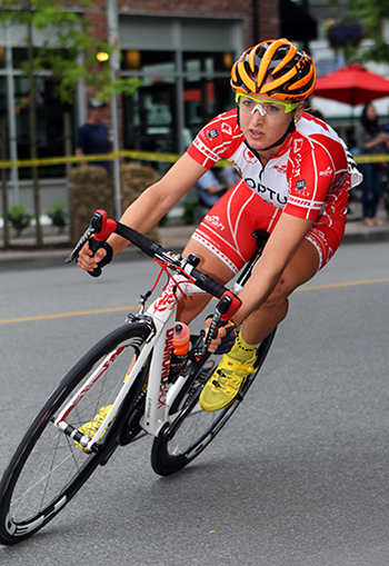 Canadian National Champion Leah Kirchmann leans into a corner during the criterium  2014 Tour de Delta. Photo by Greg Descantes for BC Superweek.