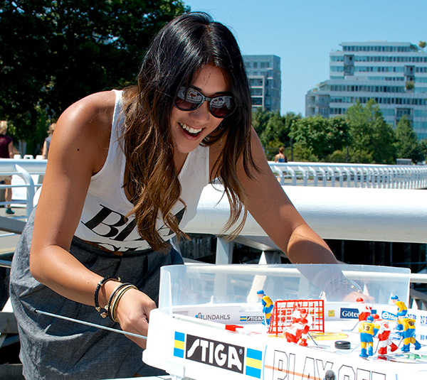 Marie Hui in her first-ever game of table hockey. Photo  by Jason Kurylo for Pucked in the Head.