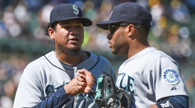 Felix Hernandez (left) fist bumps second baseman Robinson Cano late in a season that saw the Seattle Mariners miss the playoffs by a single win. Kyle Terada photo borrowed from USA Today Sports Online.