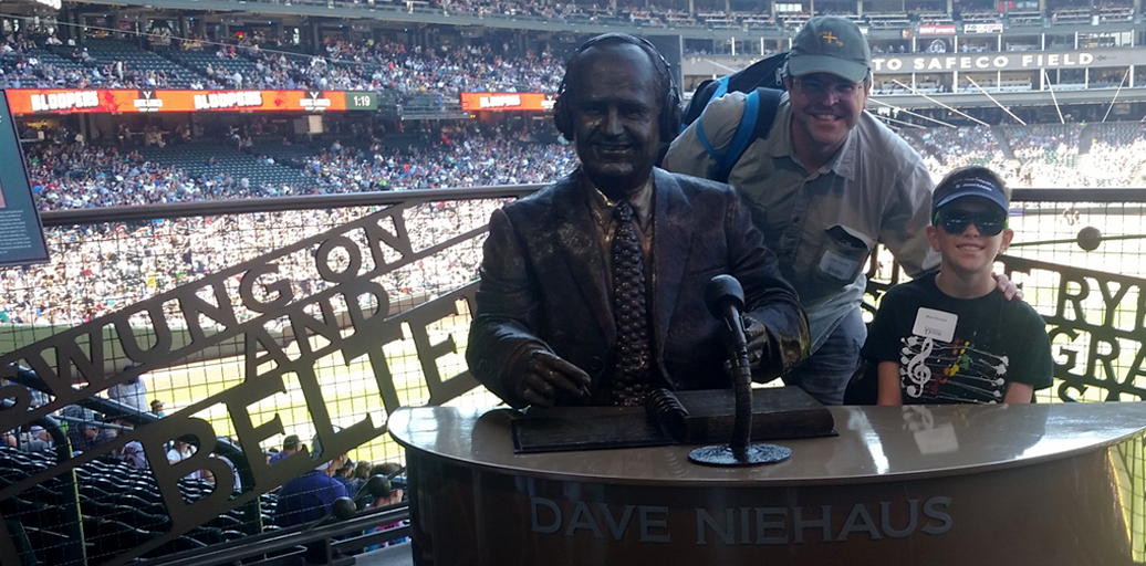 John Stewart and his son Matt visit the Dave Niehaus memorial at Safeco Field in Seattle.