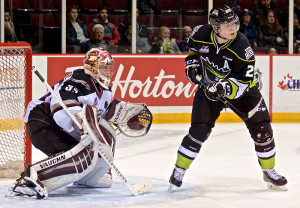 Edgars Kulda of the Edmonton Oil Kings looks for a tip in front of Vancouver Giants goaltender Cody Porter. Photo by Jason Kurylo for Pucked in the Head.