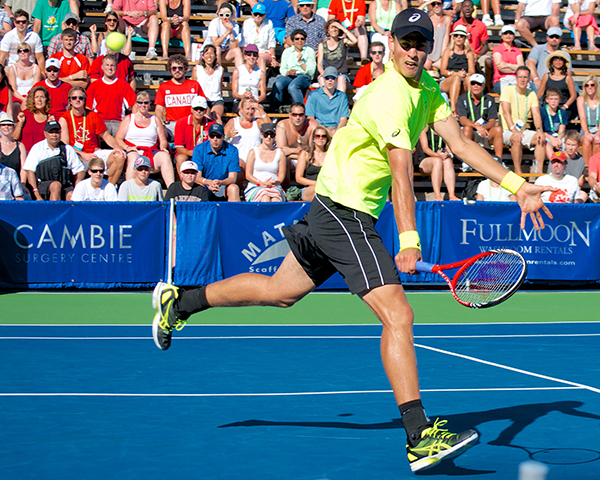 Vasek Pospisil stretches for a dramatic backhand volley during the third set of the Vancouver Open men's singles final. Photo by Jason Kurylo for Pucked in the Head.
