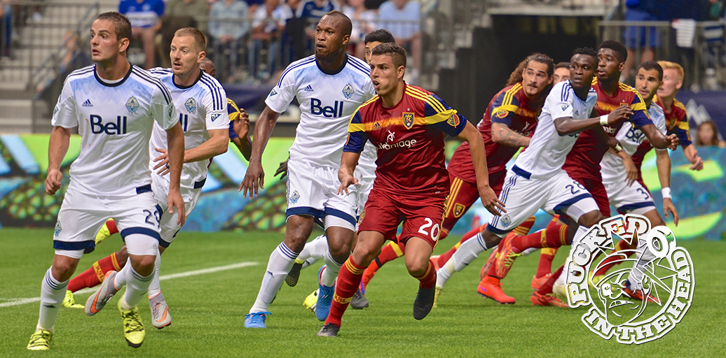 And they're off! The Vancouver Whitecaps FC and RSL look for the business end of a Pedro Morales free kick. Photo by Jason Kurylo for Pucked in the Head.