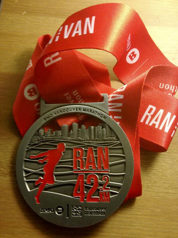 The BMO Vancouver Marathon medal is purty. But yeah, totally not worth it. Photo by Jason Kurylo for Pucked in the Head.
