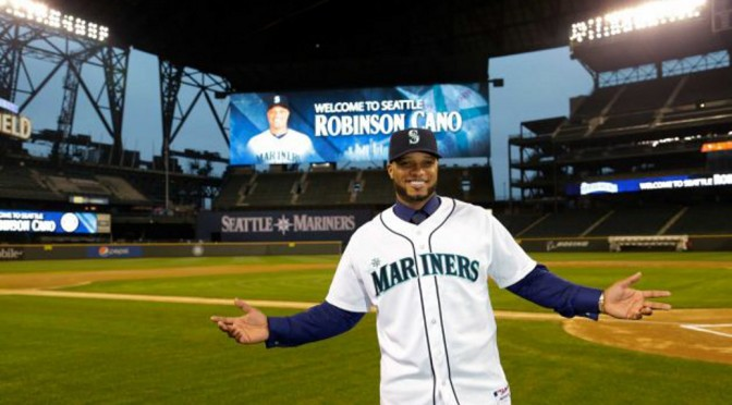 Robinson Cano showing off his sparkling new M's jersey.