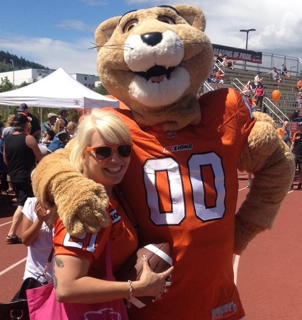 Sam Anderson (@SamelaAnderson on the mighty Twitter) cavorts with Leo the Lion at the 2013 BC Lions Fan Fest in Kamloops. Photo courtesy of Sam's Facebook page.