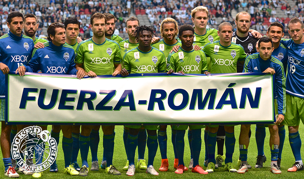 Classy move by the Sounders, honouring injured Román Torres with a banner in front of the starting XI. Photo by Jason Kurylo for Pucked in the Head.