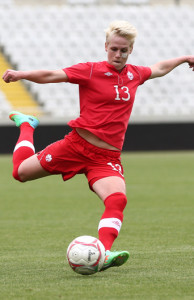 Team Canada midfielder Sophie Schmidt crosses the ball during international friendly action against the Republic of Ireland. Photo courtesy of Soccer Canada.