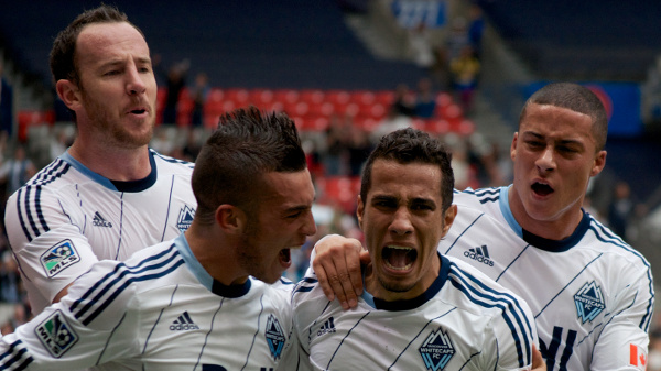 Camilo de Sanvezzo (second from right) gave the Whitecaps FC their first-ever lead against the Portland Timbers, but it was negated in the second half by a dubious penalty call. Photo by Jason Kurylo for Pucked in the Head.