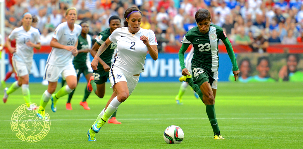 Sydney Leroux and Ngozi Ebere chase a ball during the women's world cup.