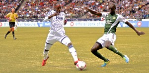 Darren Mattocks of Vancouver Whitecaps FC attempts to get round Portland Timbers defender Pa Modou Kah in MLS action. Photo by Jason Kurylo for Pucked in the Head.