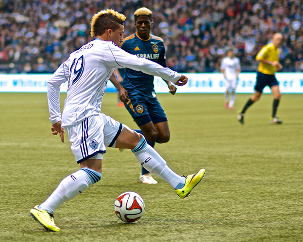 Erik Hurtado dances and deals prior to Darren Mattocks' goal during a 2-2 draw between the Whitecaps and LA Galaxy. Photo by Jason Kurylo for Pucked in the Head.