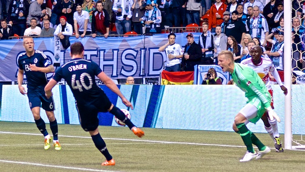 """Whitecaps FC David Ousted: """"Andy, if you don't mind, would you please make an effort to direct that errant regulation-sized football over there near the nice folks in row 23?"""" Photo by Jason Kurylo for Pucked in the Head."""