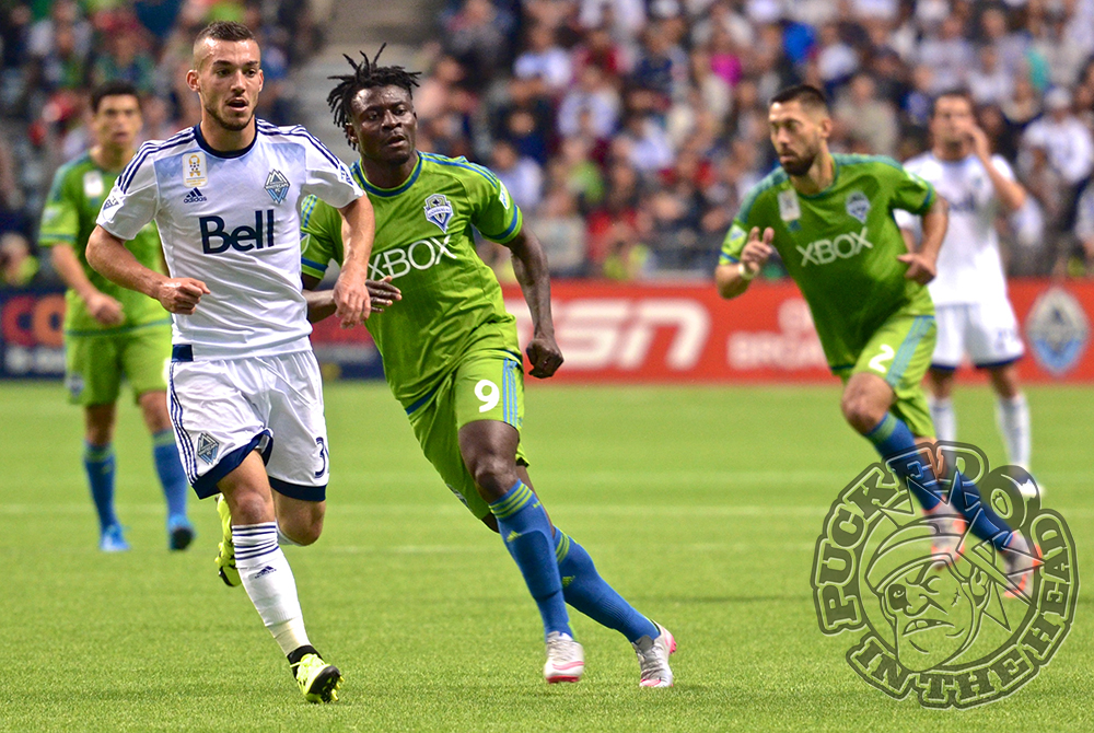 Russell Teibert keeps a close eye on Obafemi Martins during MLS action at BC Place. Photo by Jason Kurylo for Pucked in the Head.