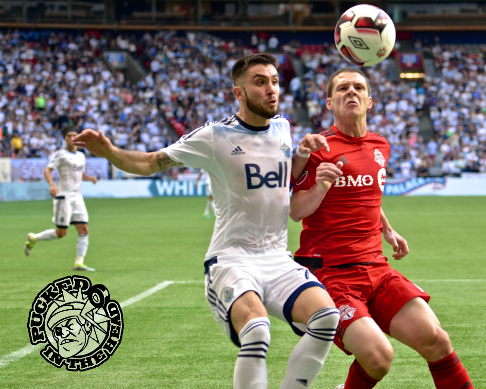 Pedro Morales and Will Johnson battle for a ball near the Toronto touch line in first half action of the Canadian Championship final. Photo by Jason Kurylo for Pucked in the Head.
