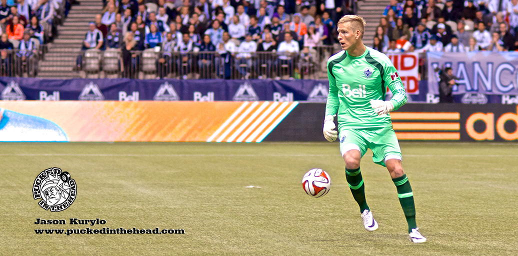 Whitecaps FC keeper David Ousted looks to move the ball upfield during a 4–1 win over the New York Red Bulls in the 2014 season opener. Photo by Jason Kurylo for Pucked in the Head.
