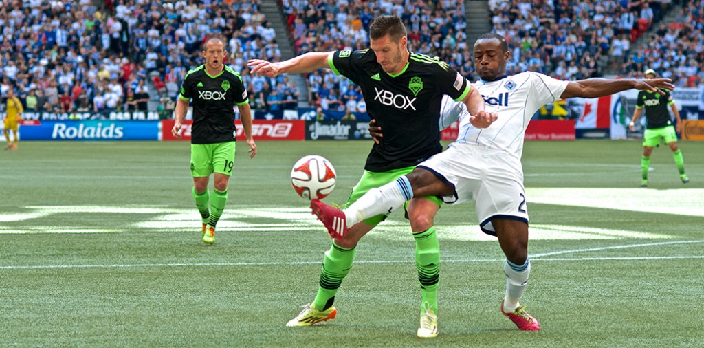 Nigel Reo-Coker battles for the ball versus the Seattle Sounders.
