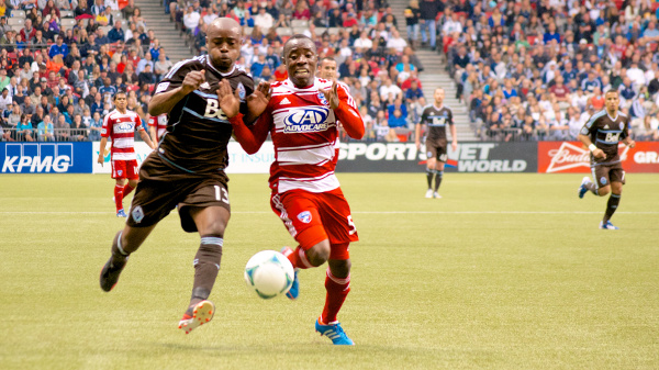 Vancouver Whitecaps FC midfielder Nigel Reo-Coker and FC Dallas defender Jair Benitez race for a ball during the first half of a 2-2 tie at BC Place on April 27, 2013. Photo by Jason Kurylo for Pucked in the Head.