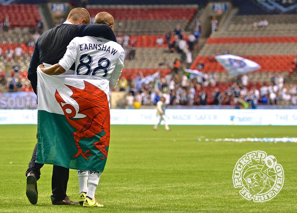 Countrymen Carl Robinson and Robert Earnshaw walk the length of the pitch draped in the Welsh flag after the Vancouver Whitecaps FC won their first-ever Amway Canadian Championship with a 2-nil victory over the Montreal Impact at B