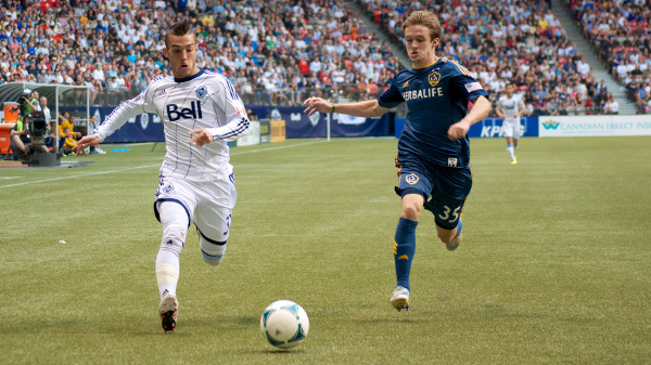Canadian product Russell Tiebert (left) scored the first two goals of his promising MLS career, as the Vancouver Whitecaps defeated the LA Galaxy 3-1 on May 11. Photo by Jason Kurylo for Pucked in the Head.