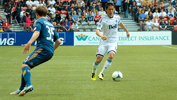 YP Lee carries the ball downfield during a 1-0 loss to the LA Galaxy at BC Place on 24 August 2013. Photo by Jason Kurylo for Pucked in the Head.