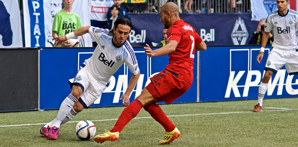 Mauro Rosales blows past Justin Morrow during first half action in the 2015 MLS season opener. The Vancouver Whitecaps lost to the dirty, rotten, stinkin' doughbugs of TFC 3-1. Photo by Jason Kurylo for Pucked in the Head.