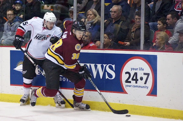 Defenseman Jeremy Blain wins a battle along the boards for the Chicago Wolves during a 1-0 win over the Abbotsford Heat on January 13, 2013. Photo by Jason Kurylo for Pucked in the Head.